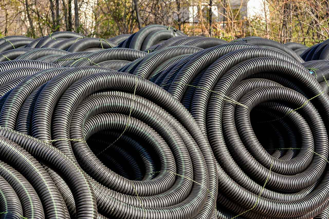 Image of coiled drainage pipes in Berkshire and Surrey - Let the digger do it, flood prevention in Berkshire and Surrey.