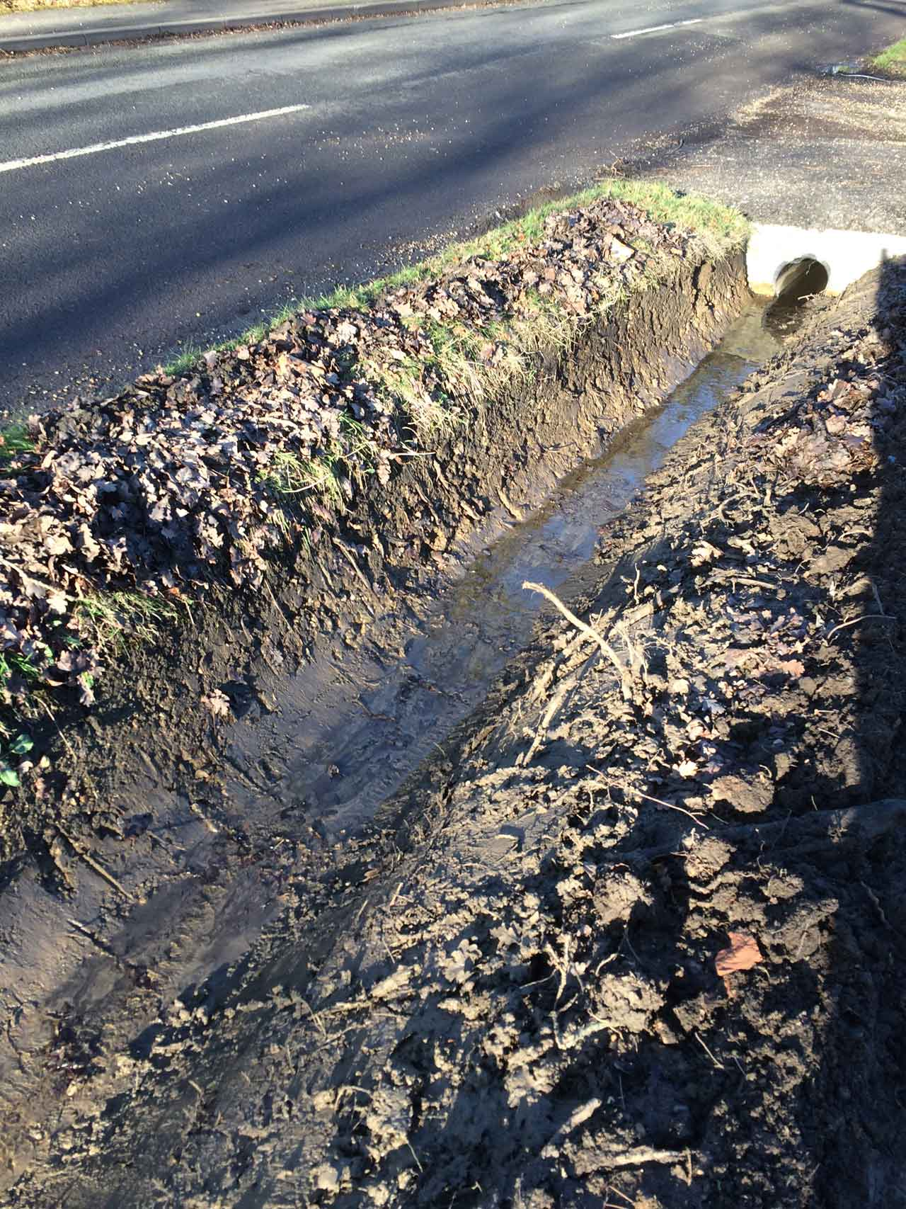 Image of a ditch after cleaning - Ditching, ditch-cleaning for correct drainage and flood minimisation - Let the digger do it - Winnersh - Wokingham -Berkshire - Hampshire - Surrey - digger ditch cleaning services.