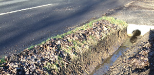 Image of a ditch after cleaning - Ditching, ditch-cleaning for correct drainage and flood minimisation - Let the digger do it - Winnersh - Wokingham -Berkshire - Hampshire - Surrey - backhoe ditch cleaning services.