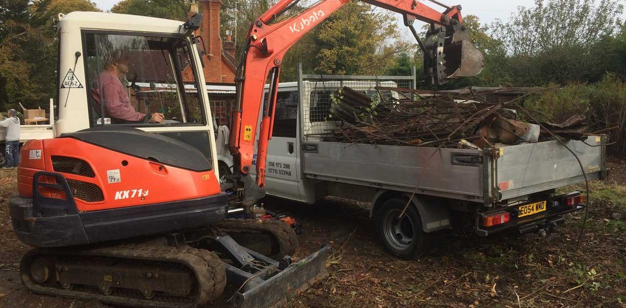 Image of a Kubota loading a truck with rubbish - Land clearance in Ascot, Berkshire - land clearing by excavator and JCB, including rubbish clearance and rubbish removal, preparing for seeding in Ascot, Berkshire - let the digger do it!